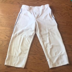 White baseball pants with blue piping on side